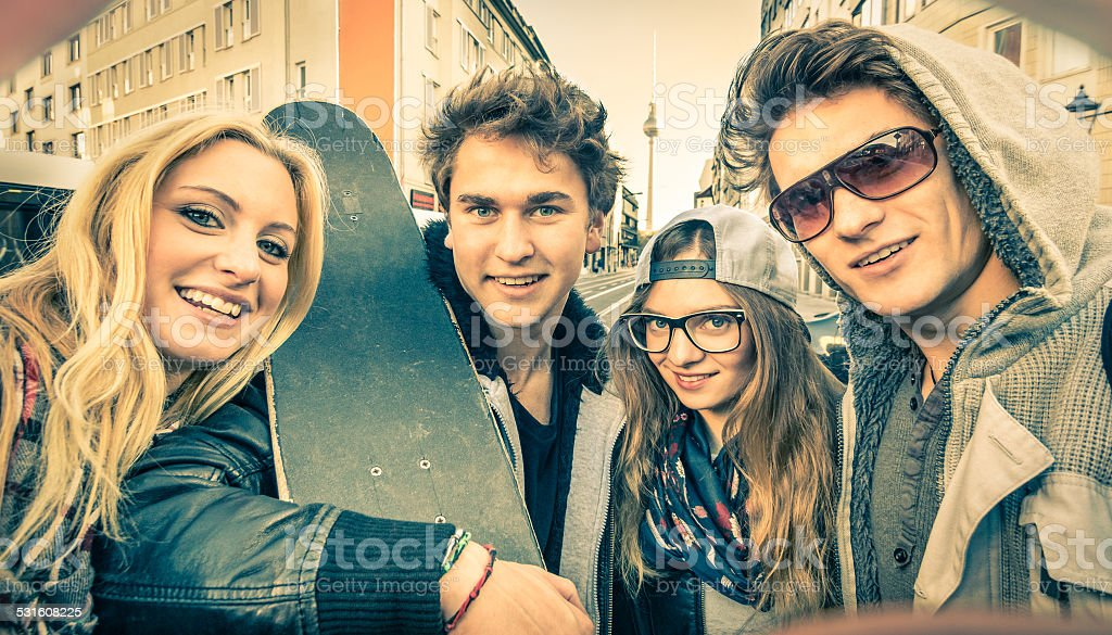 Young urban best friends taking a selfie in the city stock photo