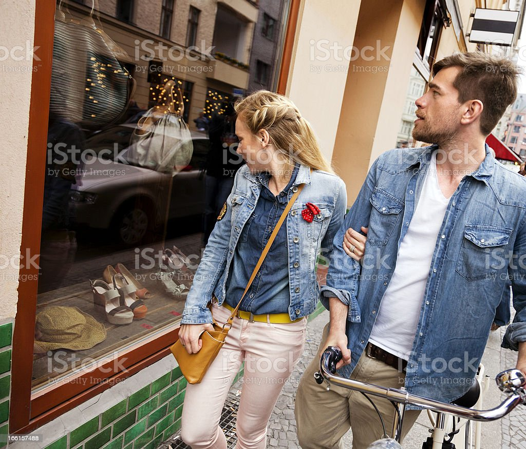 Young Urban Couple Window Shopping stock photo