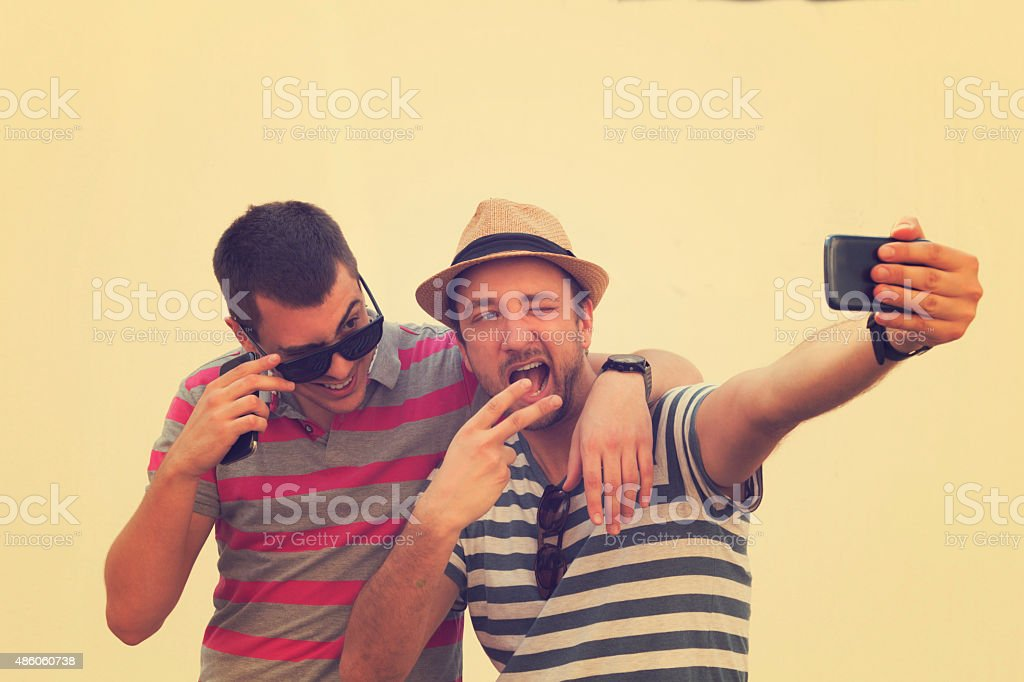 Young urban guys using a smartphone. stock photo