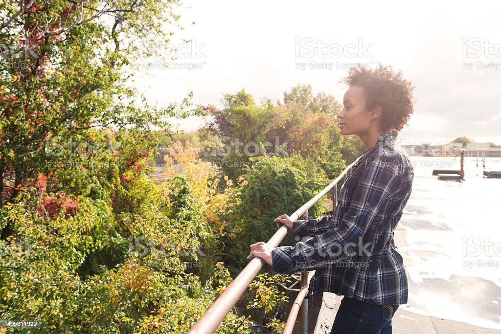 Young Urban Professional Black American Enjoys Autumn Brooklyn View NYC stock photo
