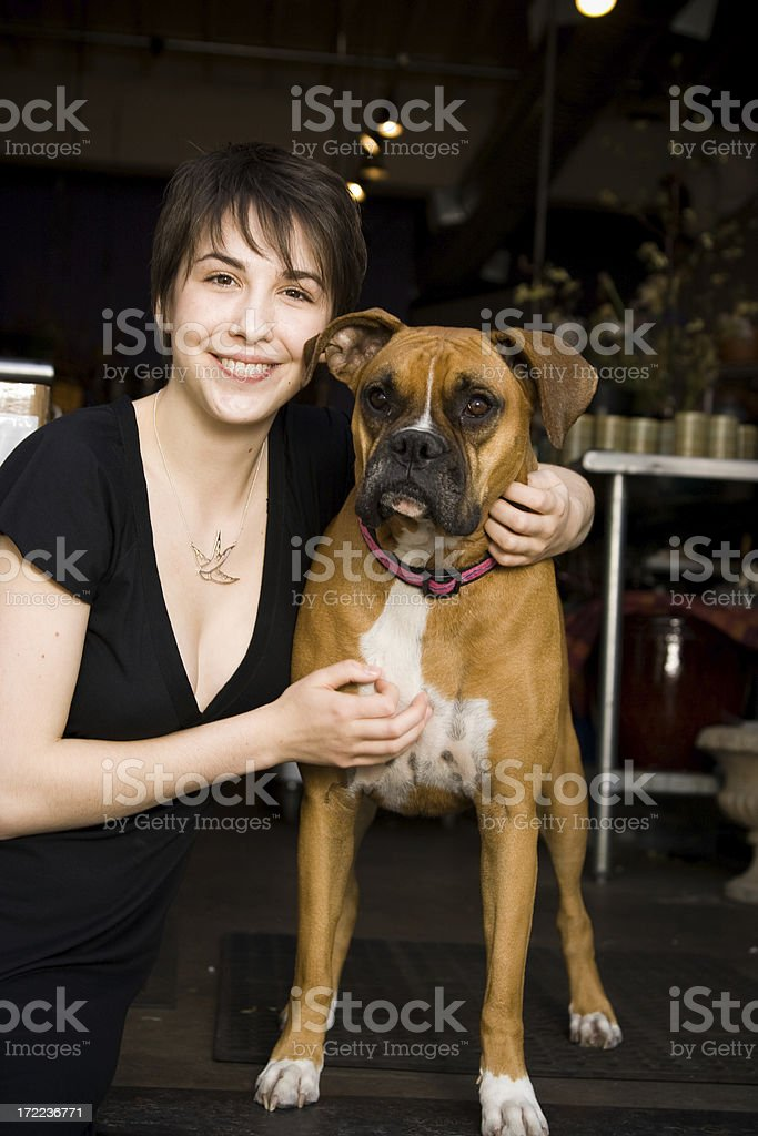 young urban woman and a boxer (dog) royalty-free stock photo