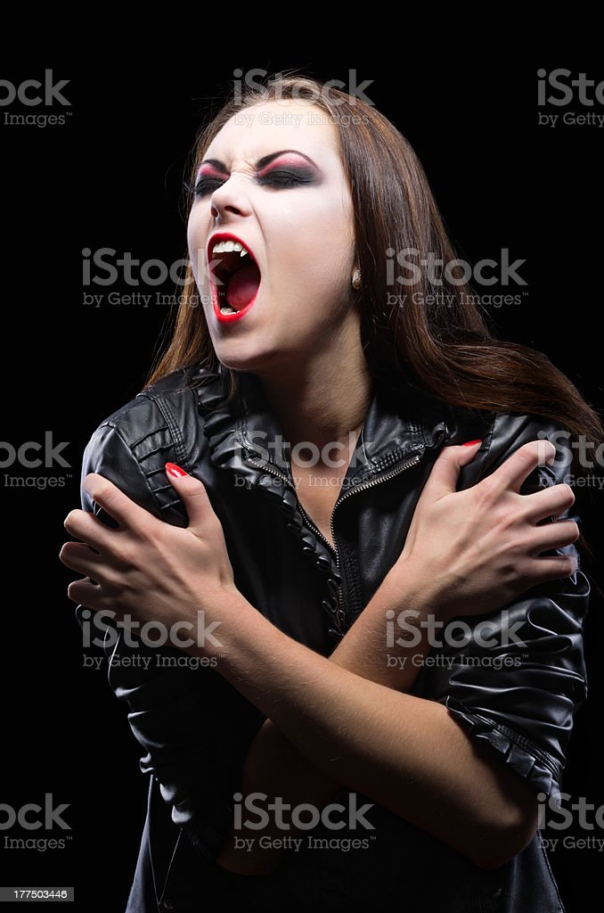Young vampire girl isolated stock photo