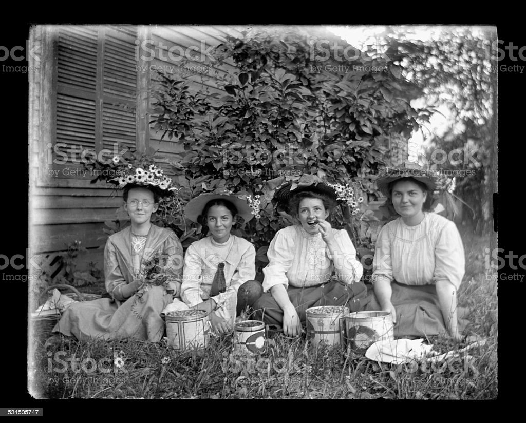 Young, Victorian-era, Girls Eating Cherries royalty-free stock photo