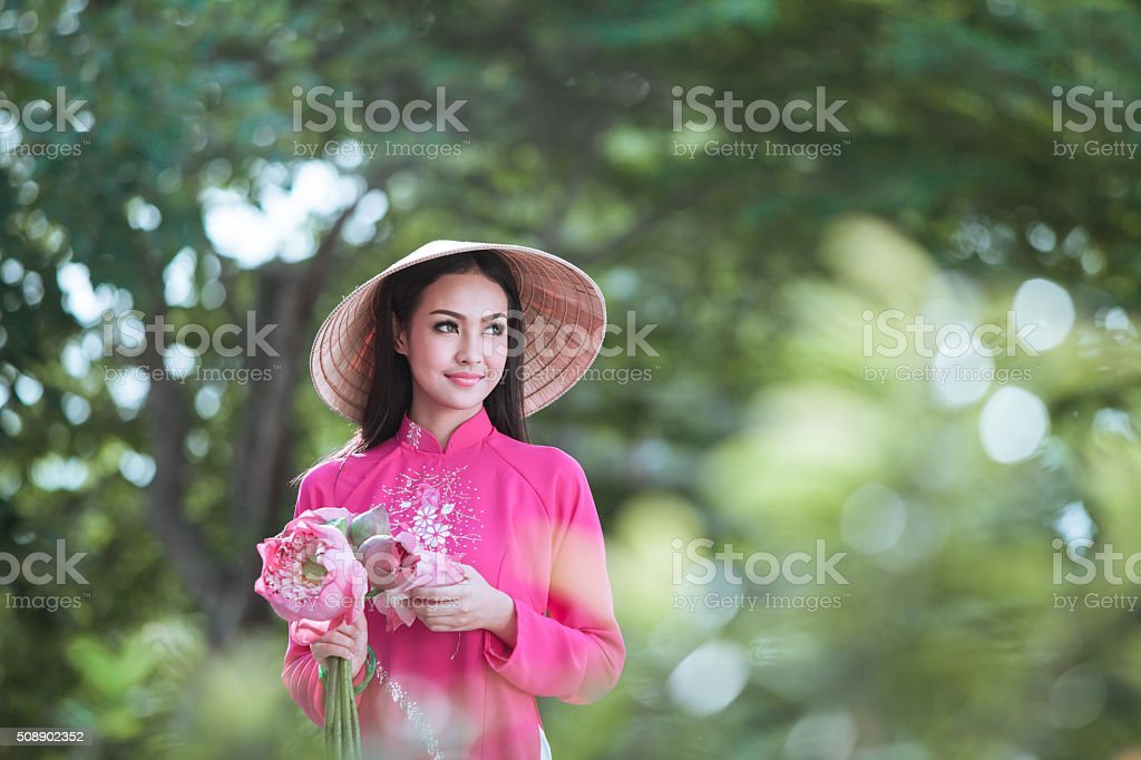 Young vietnamese woman in traditional clothing. stock photo