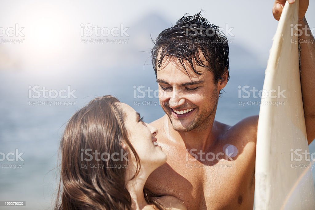 Young vintage couple enjoying time on the beach royalty-free stock photo