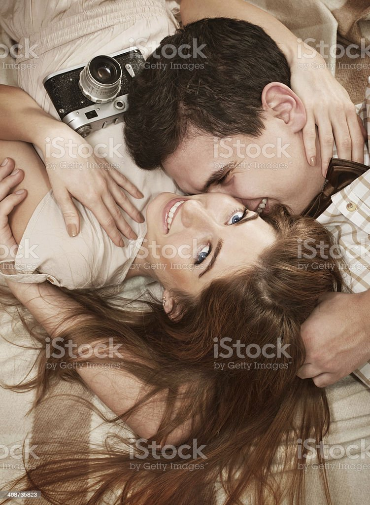 young vintage style sensual couple lying on the blanket stock photo