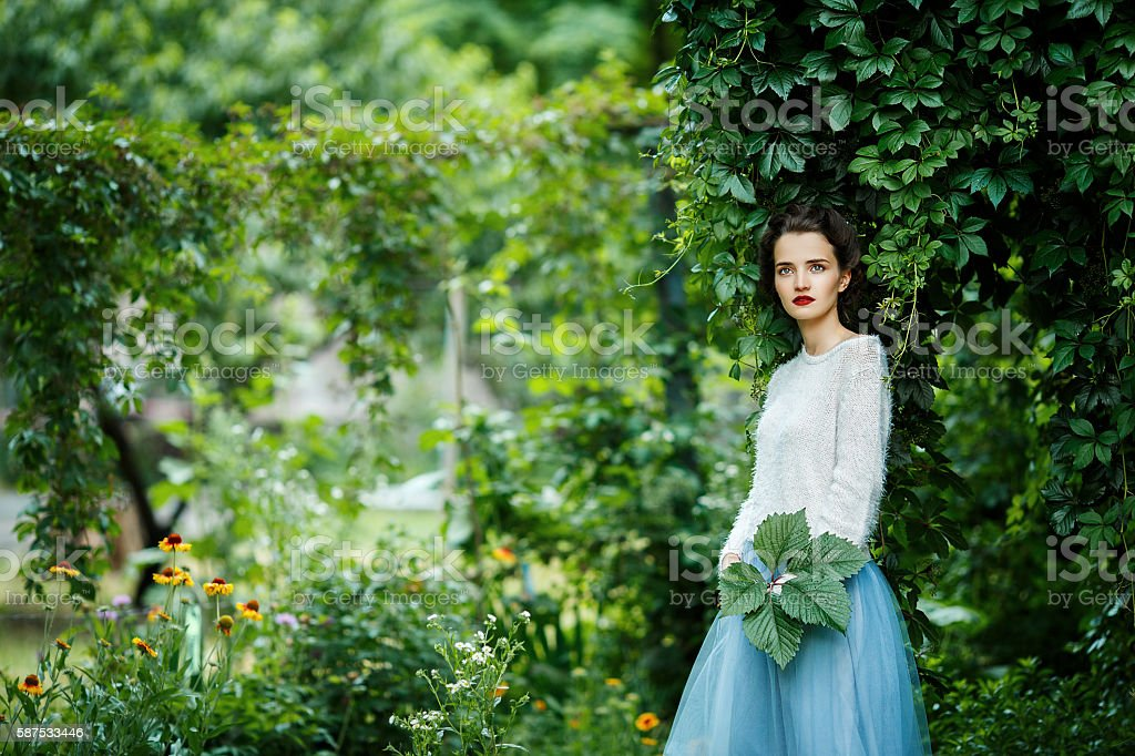 young vintage style woman posing in a vineyard stock photo