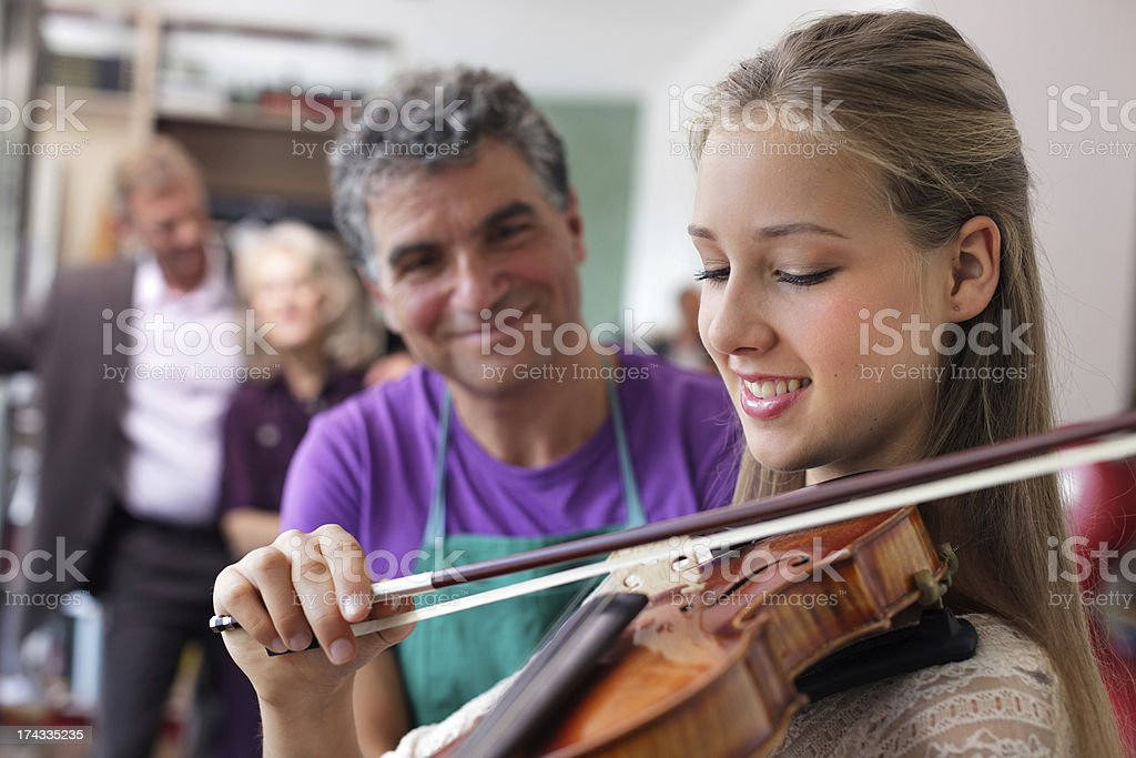 Young Violinist with First Instrument stock photo