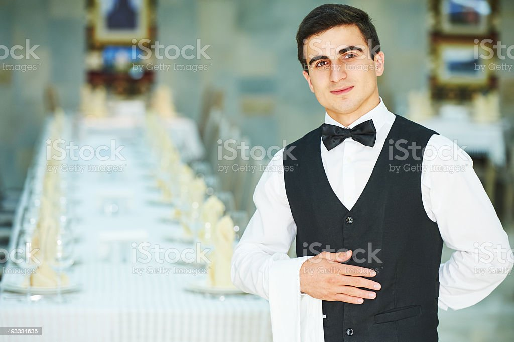 young waiter at service in restaurant stock photo