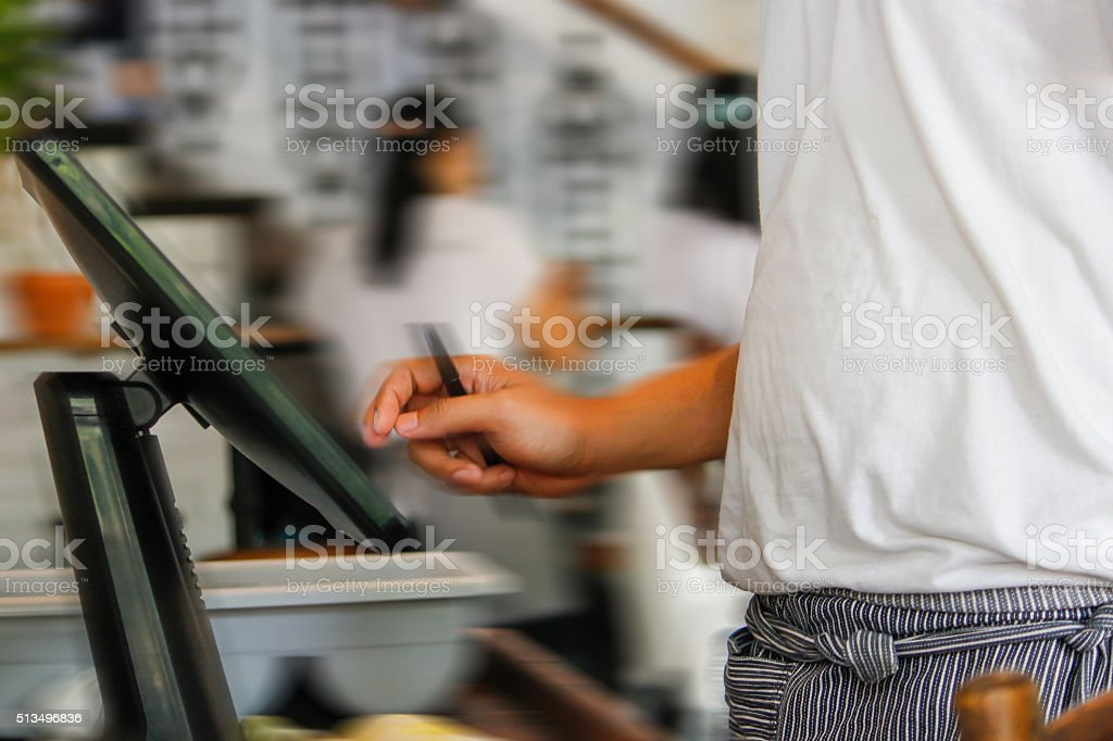 Young waiter placing customer order stock photo