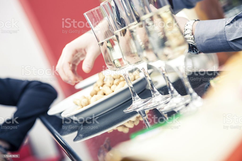 Young Waiter serve guests in a bar stock photo