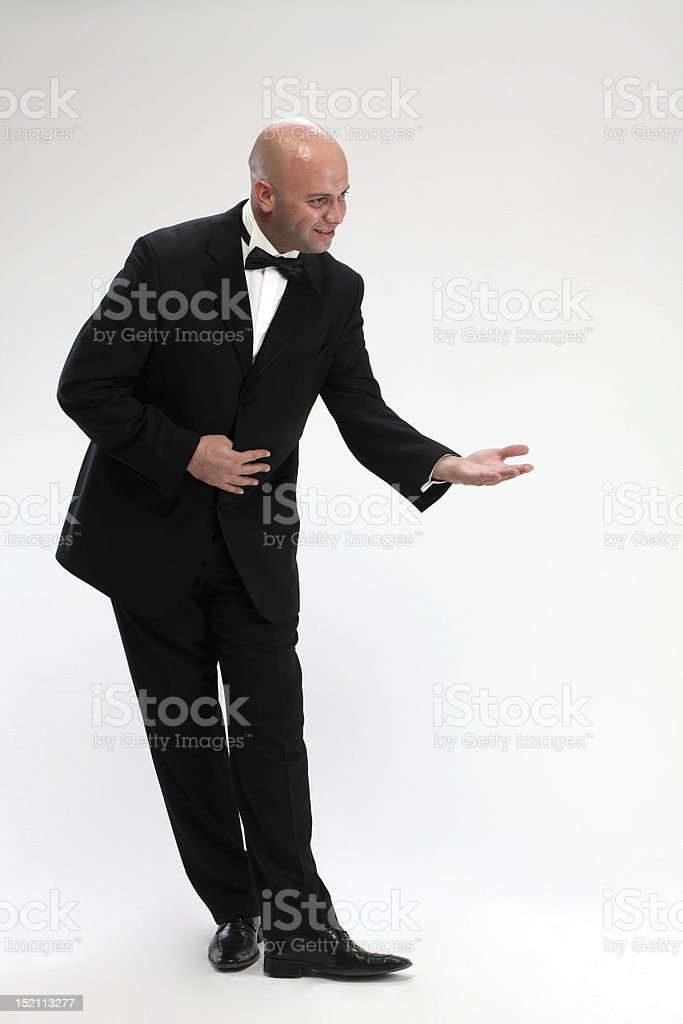 Young waiter with tuxedo stock photo
