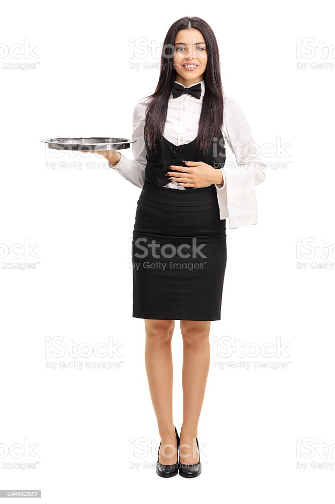 Young waitress holding a gray metal tray stock photo