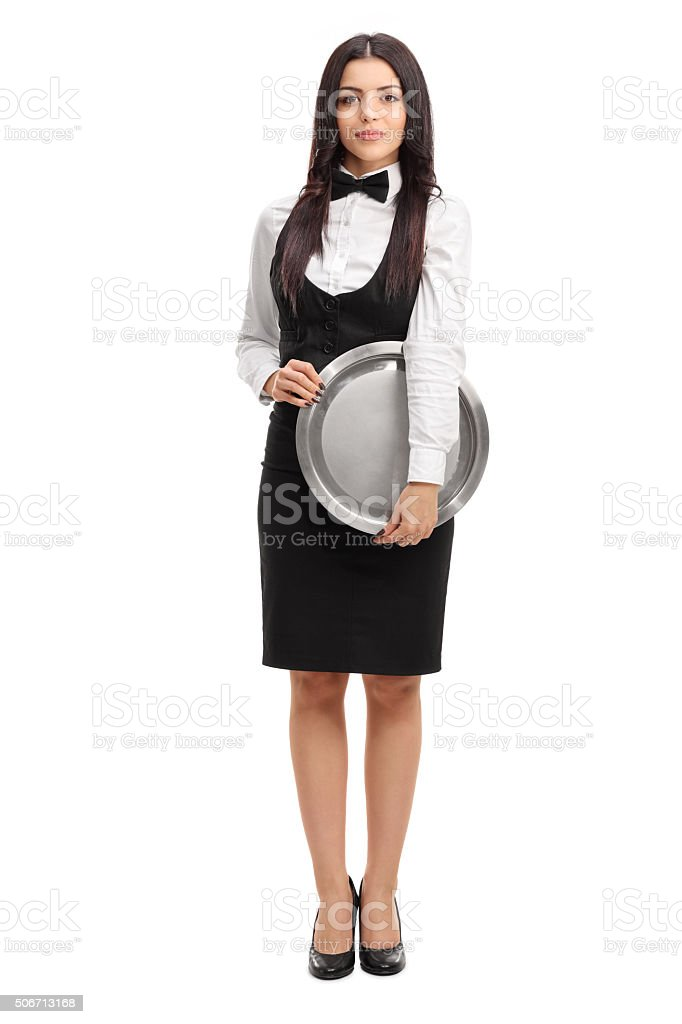 Young waitress holding a metal tray stock photo