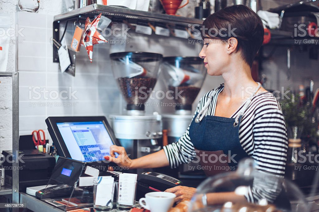 Young waitress is taking order stock photo