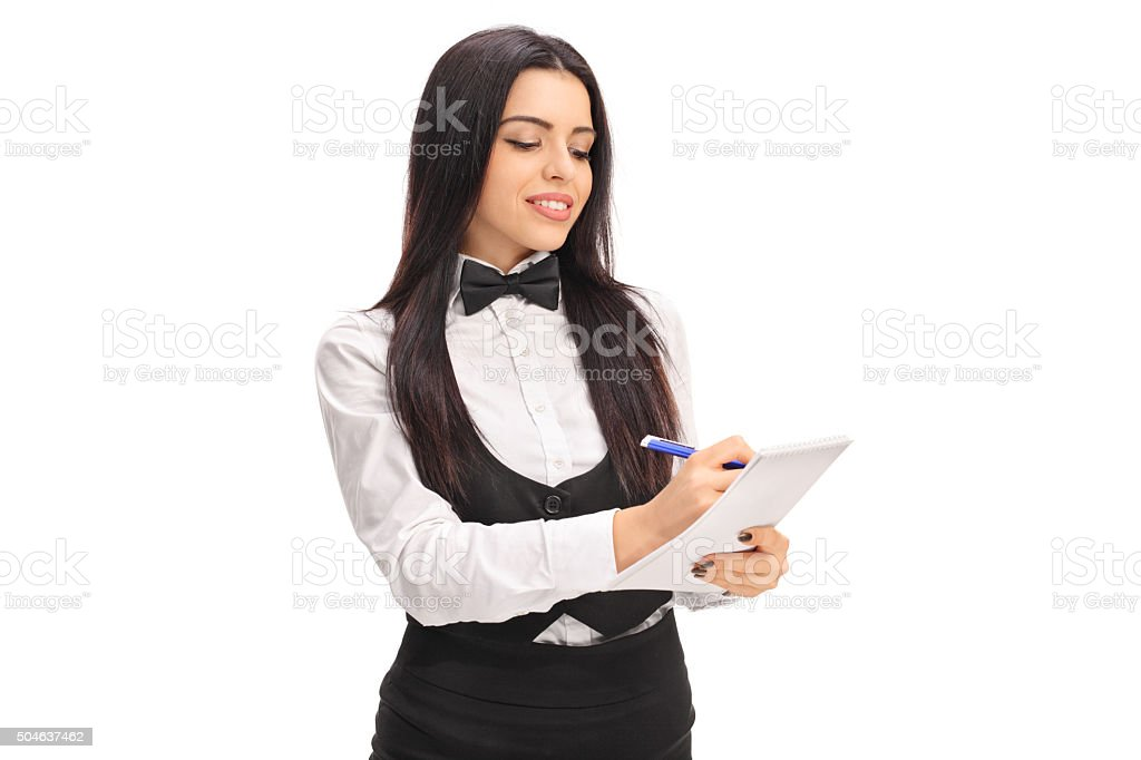Young waitress writing on a notebook stock photo