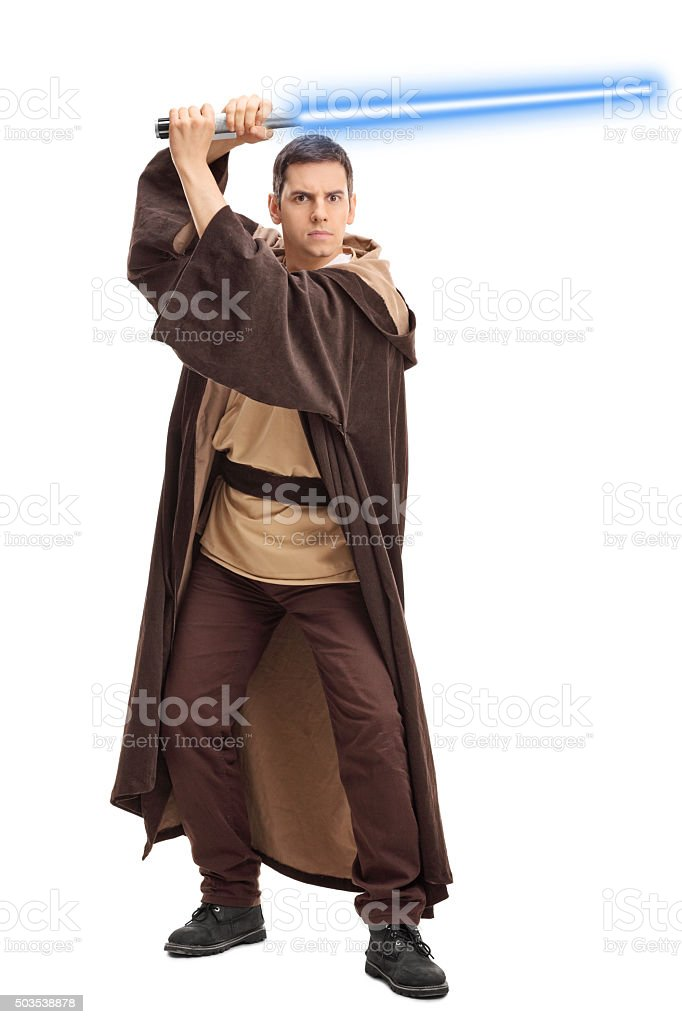 Young warrior holding a laser sword stock photo