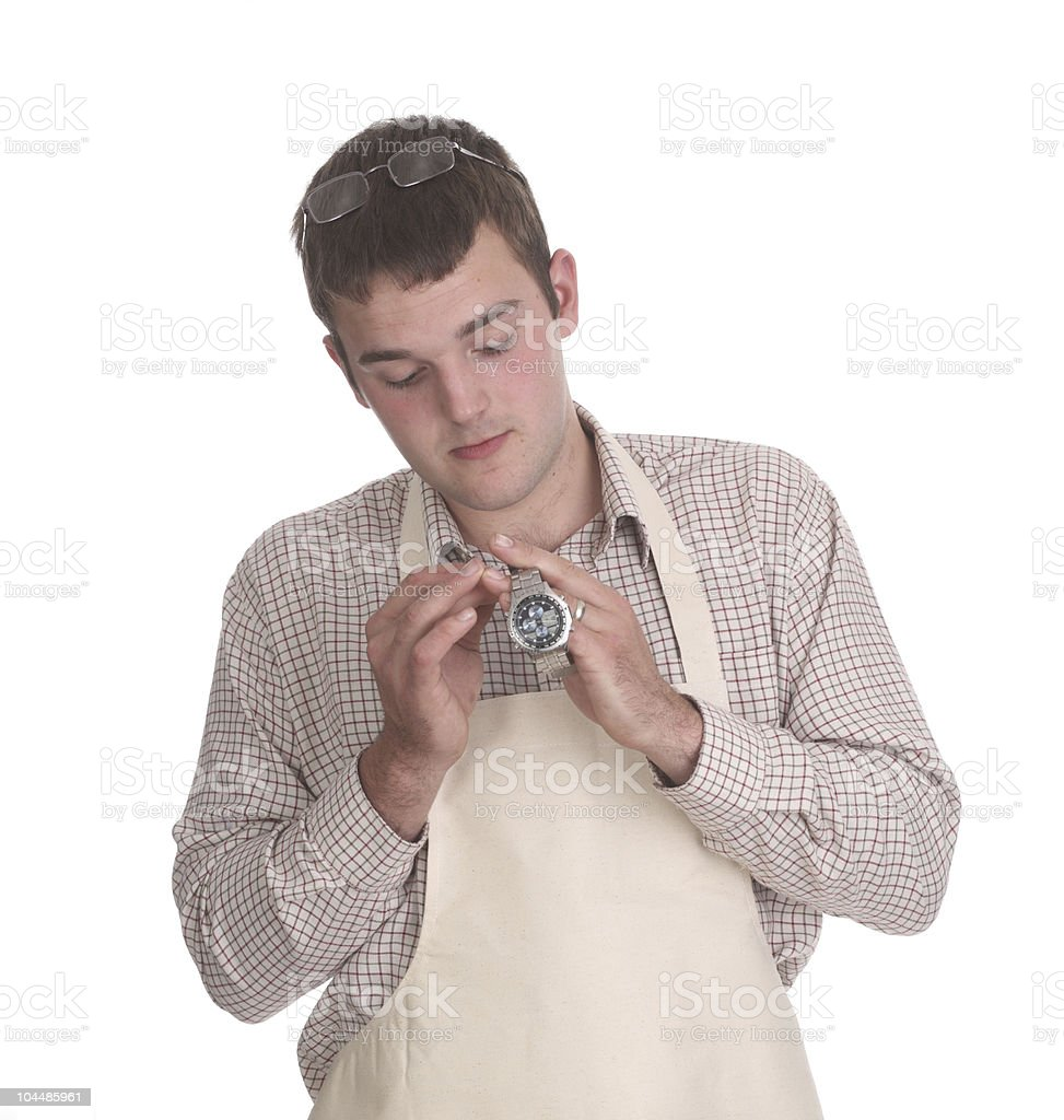 Young watch repair man stock photo