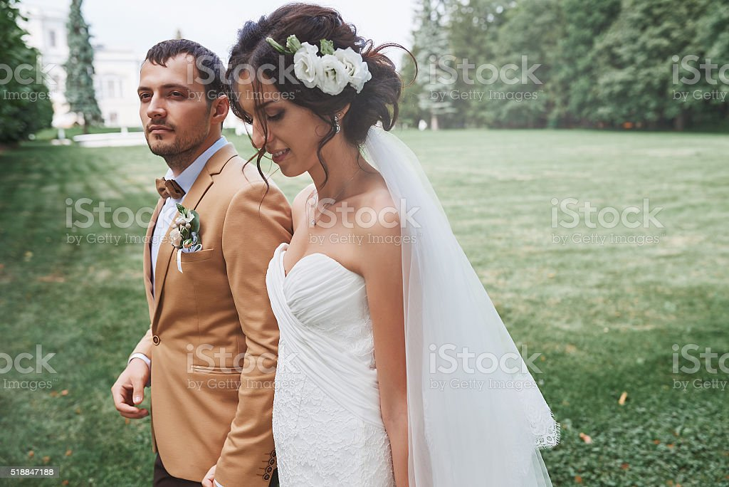 Young wedding couple enjoying romantic moments outside stock photo