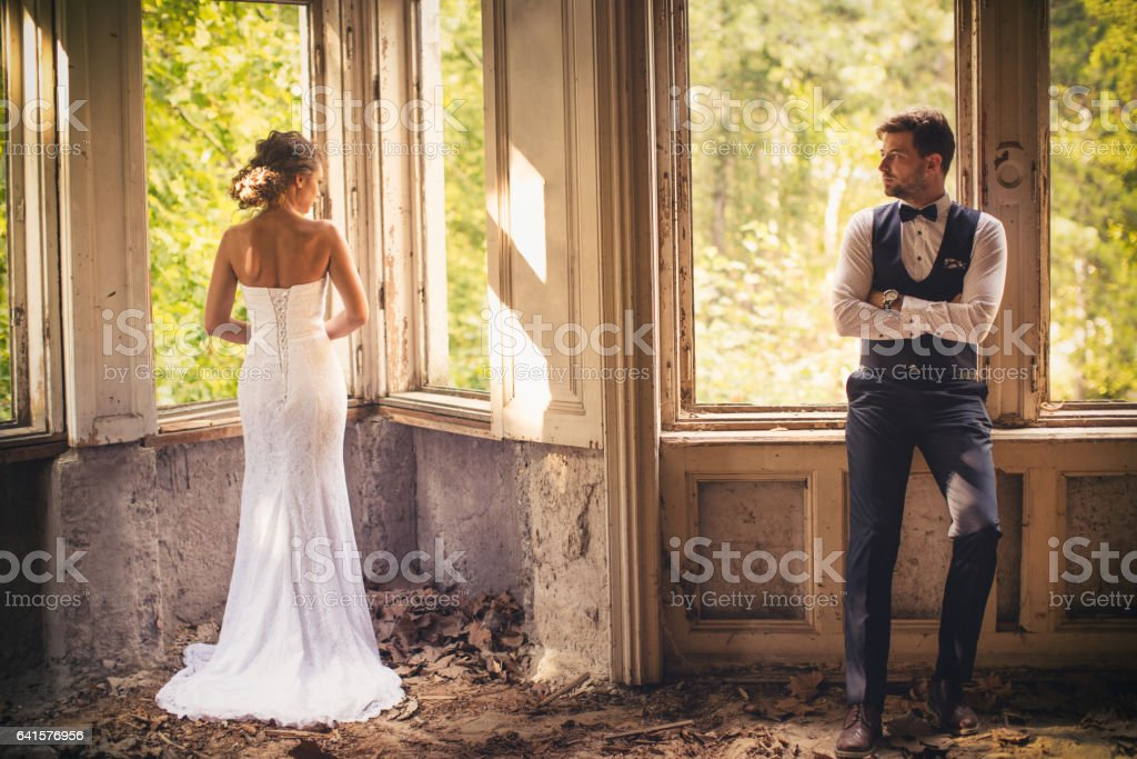 Young wedding couple posing outdoors stock photo
