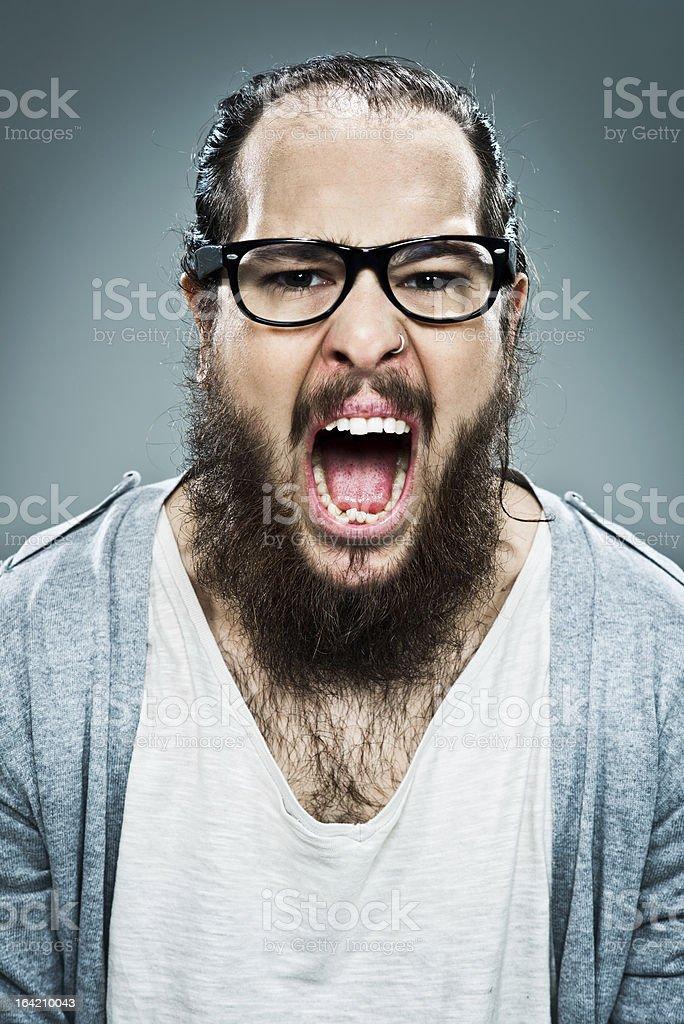 Young Weird Man Shouting at Camera stock photo
