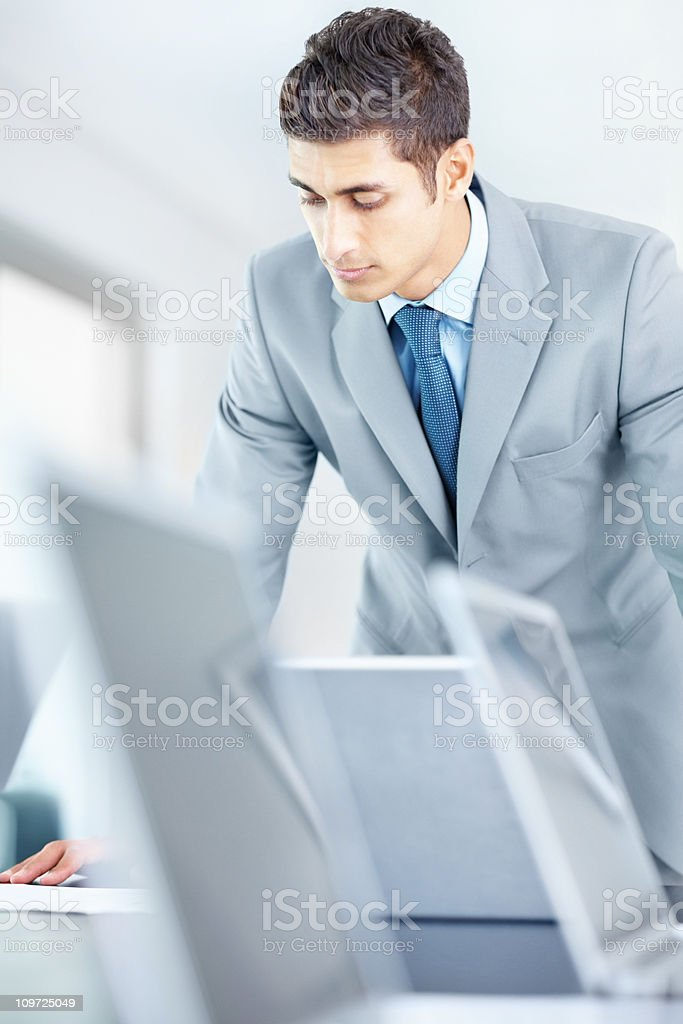 Young well-dressed businessman looking in laptop royalty-free stock photo