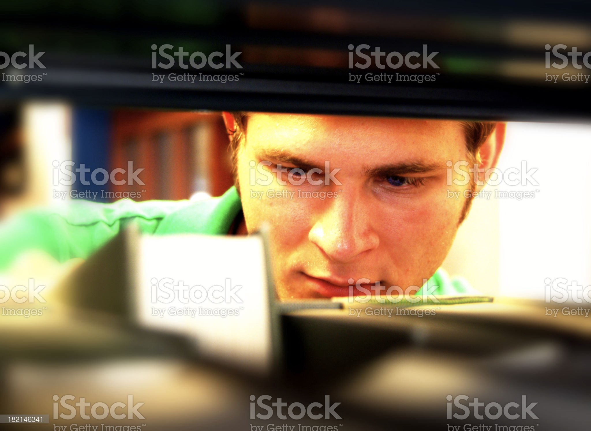 Young white adult looking for a book royalty-free stock photo