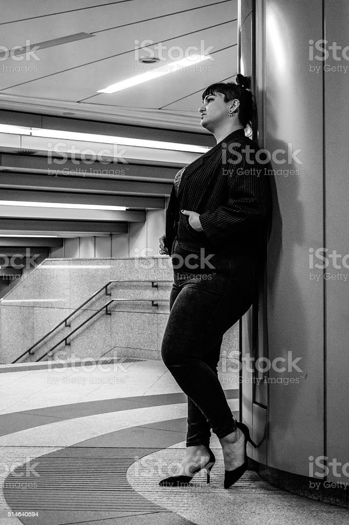 Young White Female Waiting With Hands In Pockets stock photo