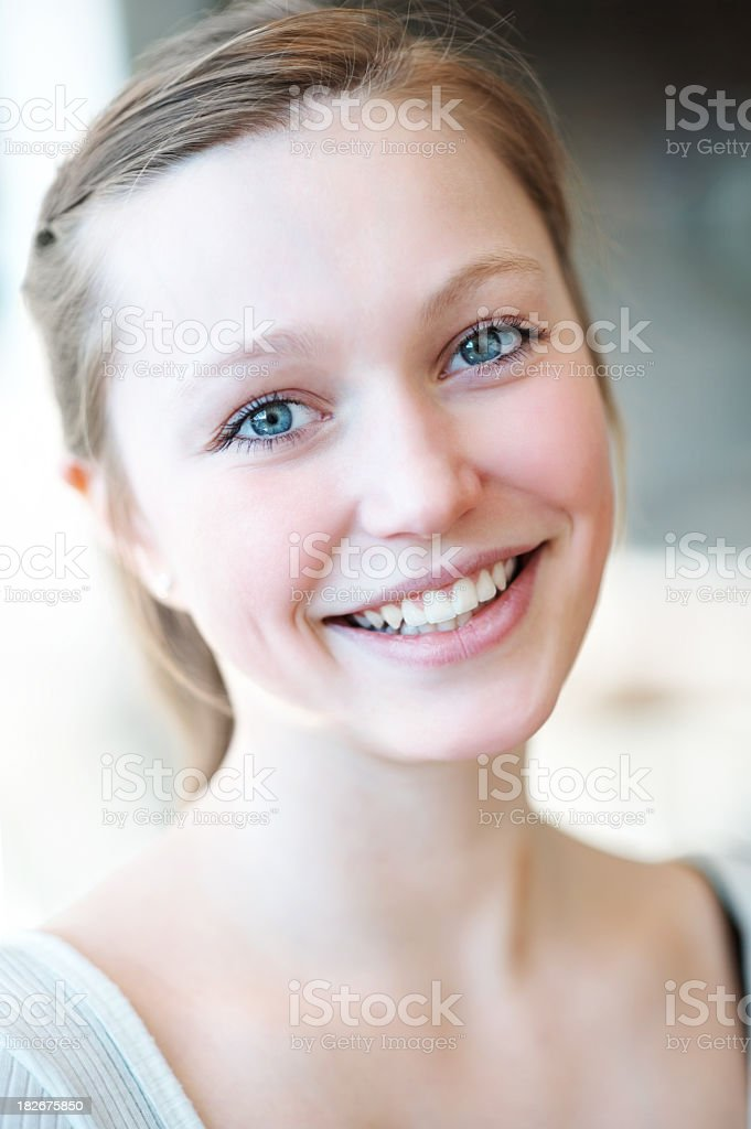 Young white female with a broad and cute smile royalty-free stock photo