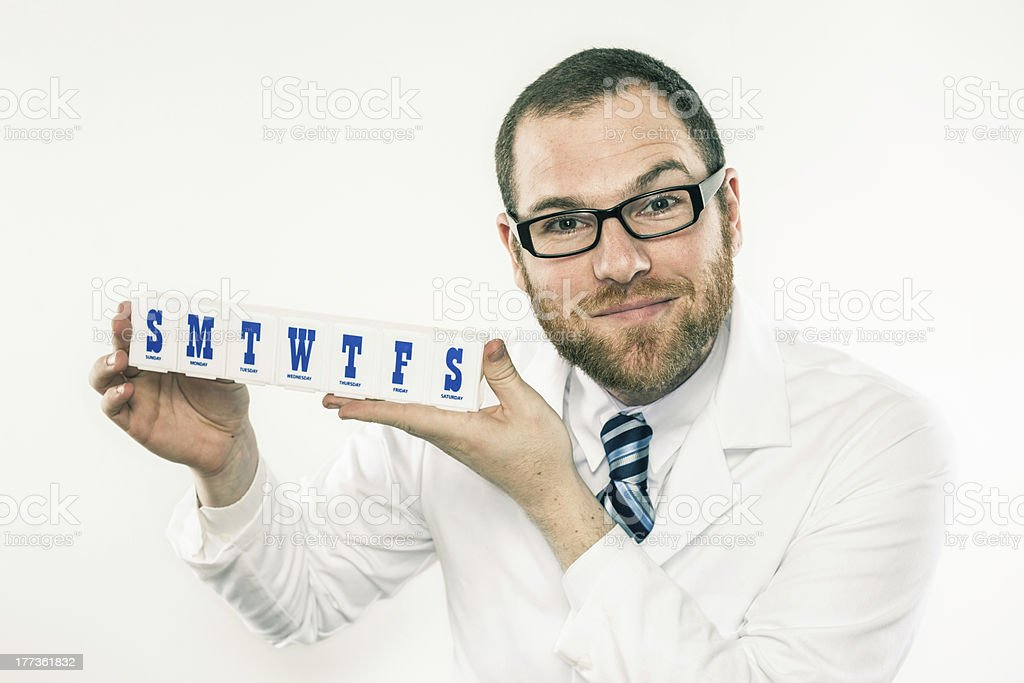 Young white male doctor holding weekly medicine holder stock photo