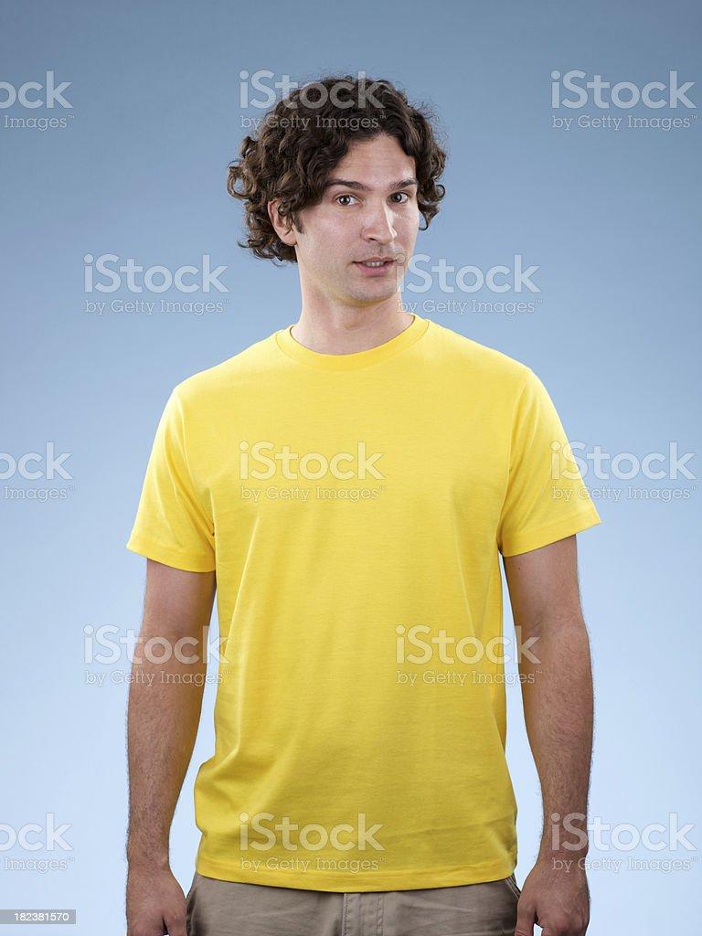 Young white male wearing yellow shirt stock photo