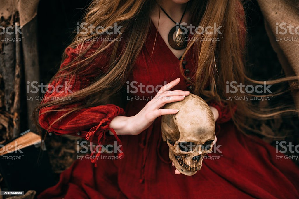 Young witch in the autumn forest stock photo