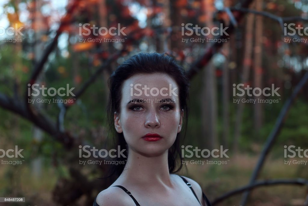 young witch in the woods, stock photo