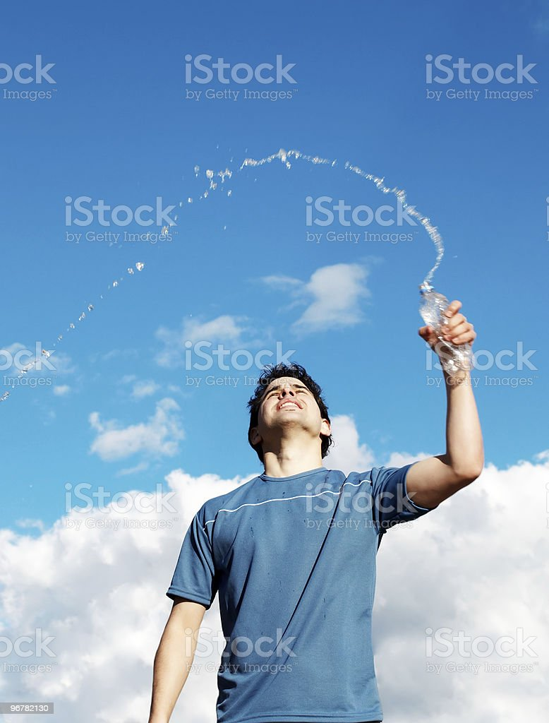 Young with bottle water against the sky stock photo