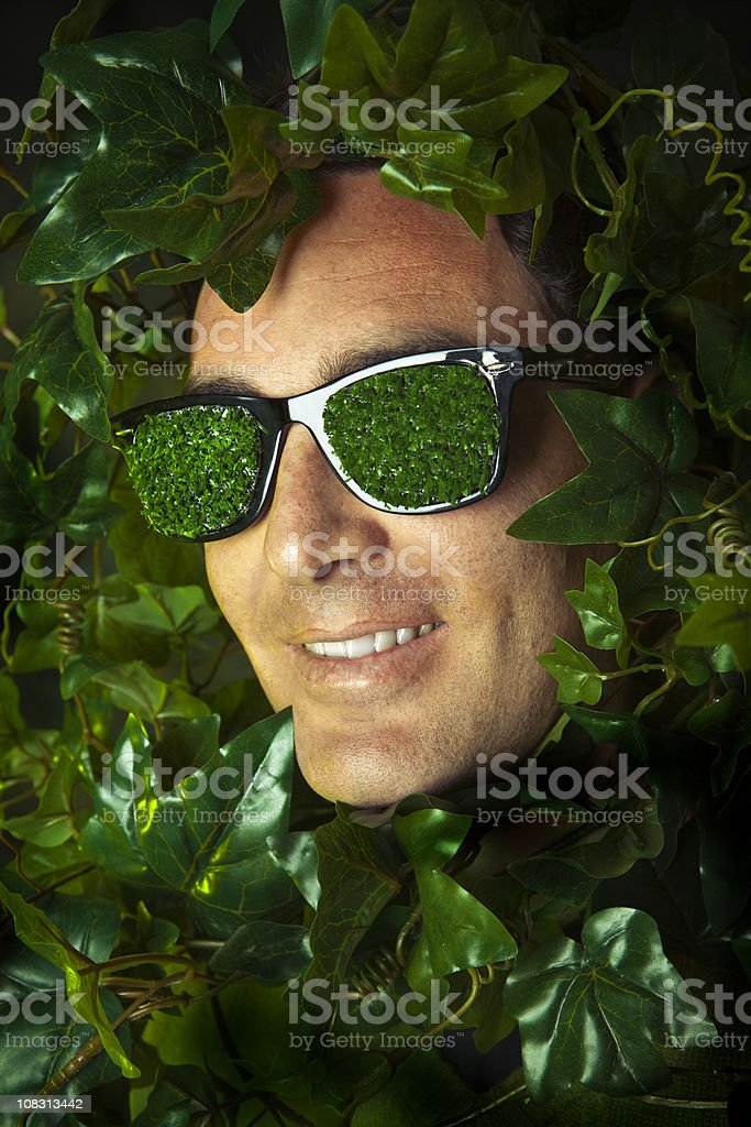 Young with grass sunglasses in ivy leaves royalty-free stock photo