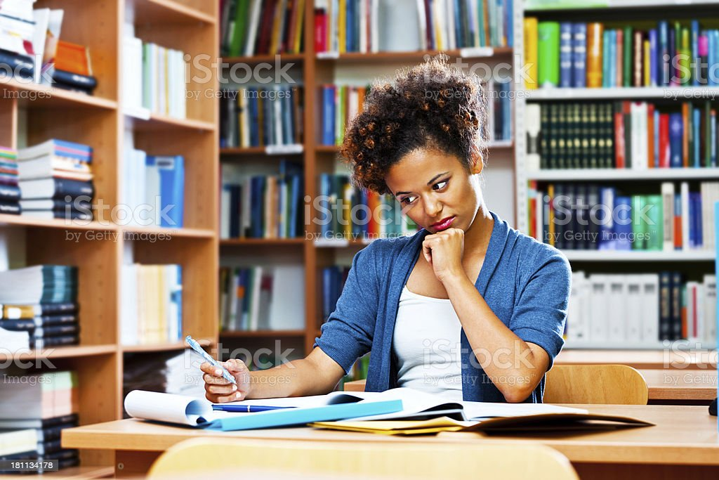 Young woman a library royalty-free stock photo