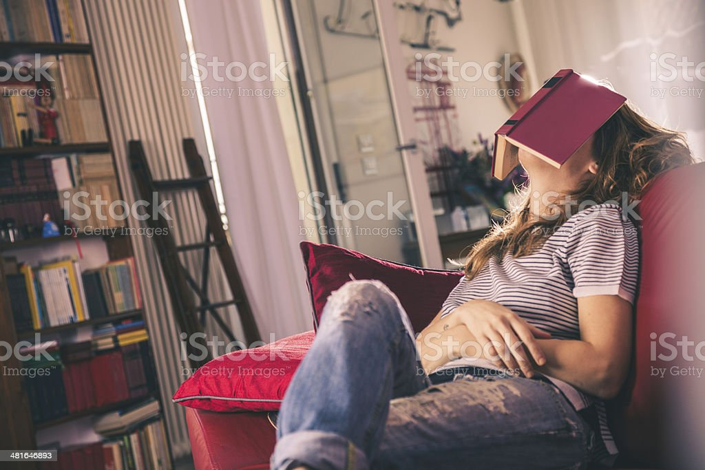 Young woman absorbed in the reading of a book stock photo