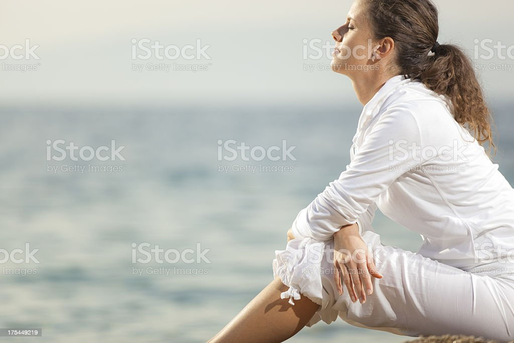 young woman absorbed in thought stock photo