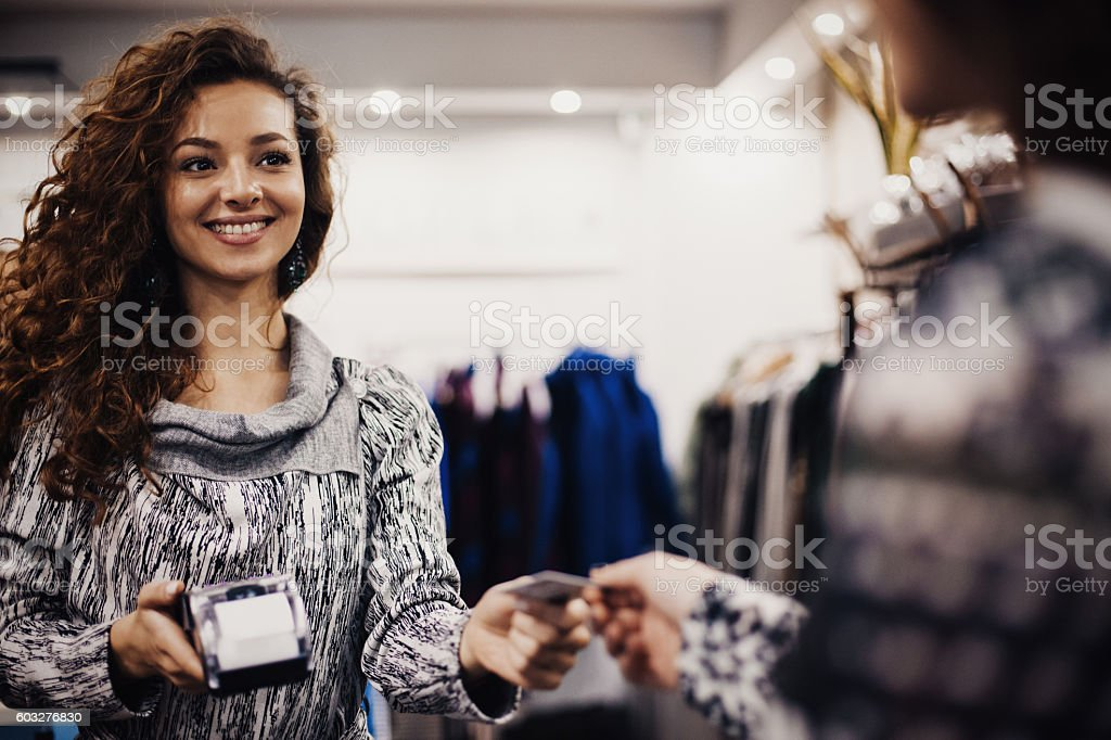 Young woman accepting a credit card payment stock photo