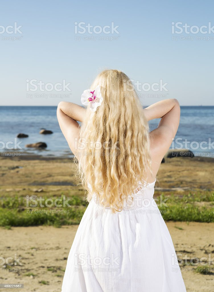 Young woman adjusting her gold hairs royalty-free stock photo