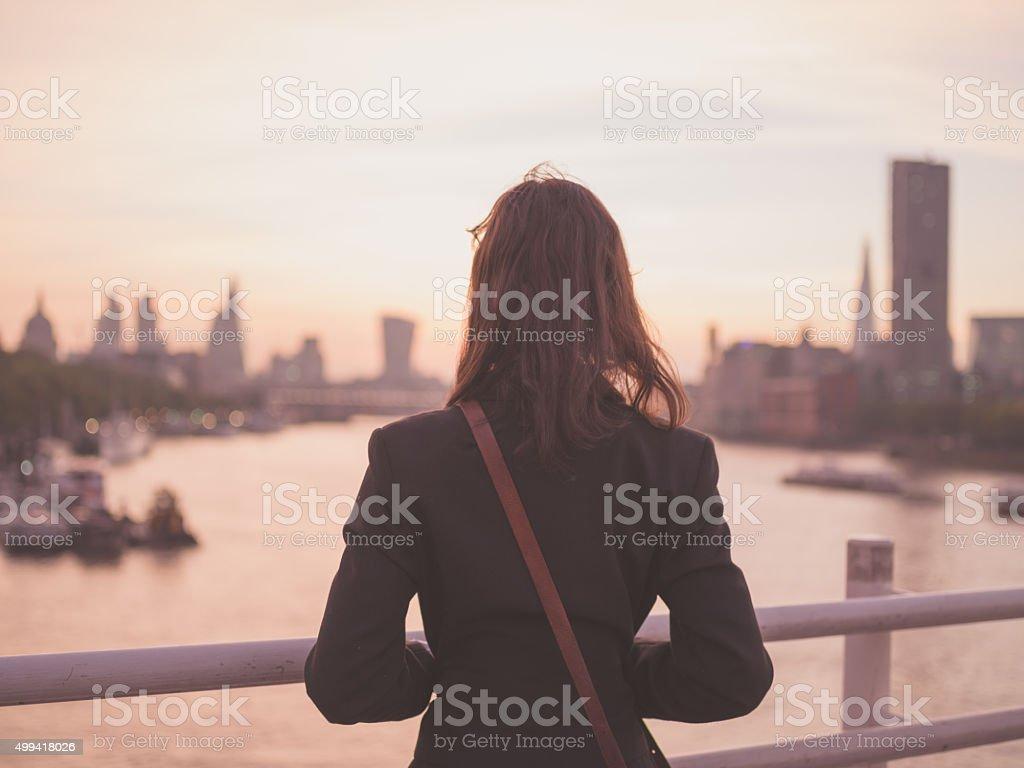 Young woman admiring London at sunrise stock photo