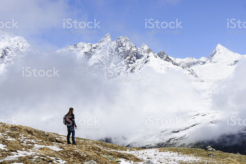 Young woman admiring snow covered mountain range royalty-free stock photo