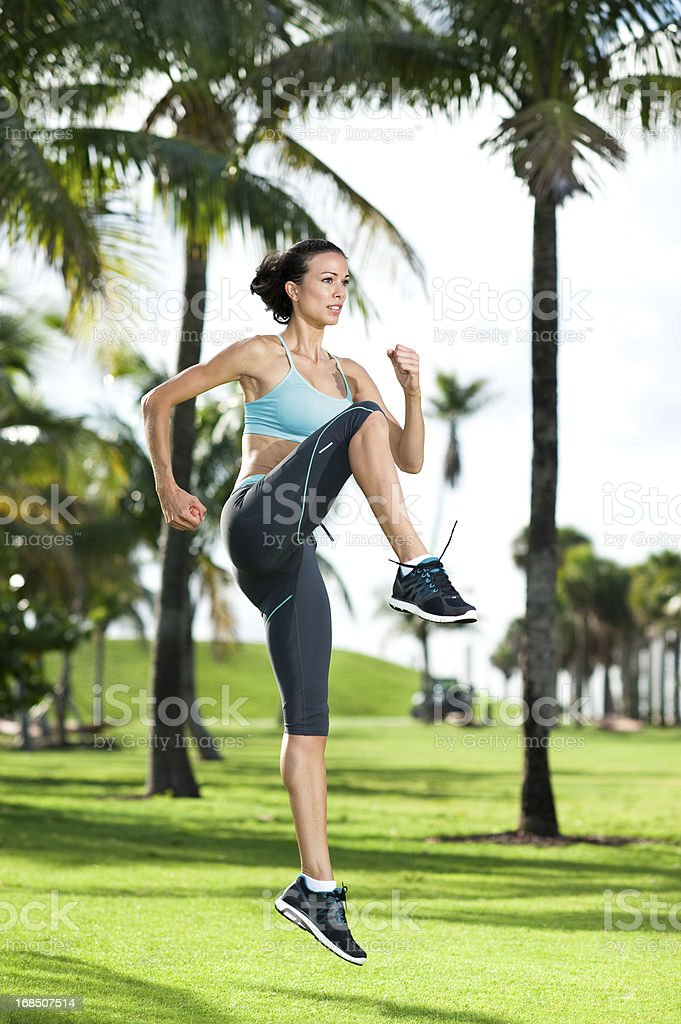 Young Woman Aerobics Instructor Exercising in Park stock photo