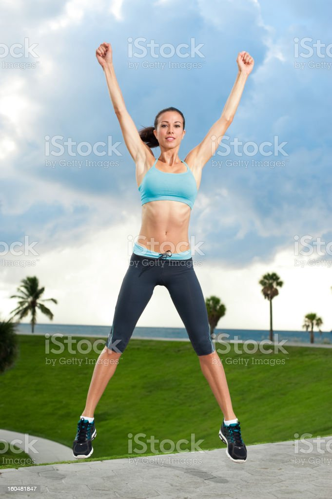 Young Woman Aerobics Instructor Exercising on Beach stock photo