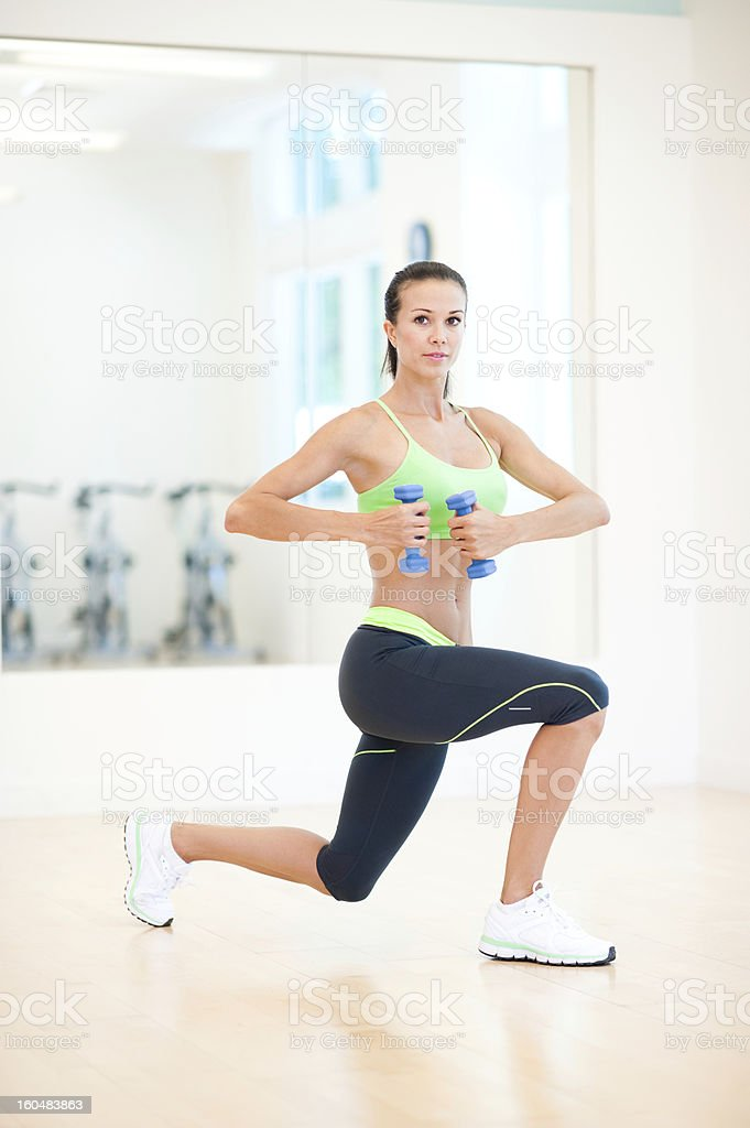 Young Woman Aerobics Instructor Working Out in Gym royalty-free stock photo