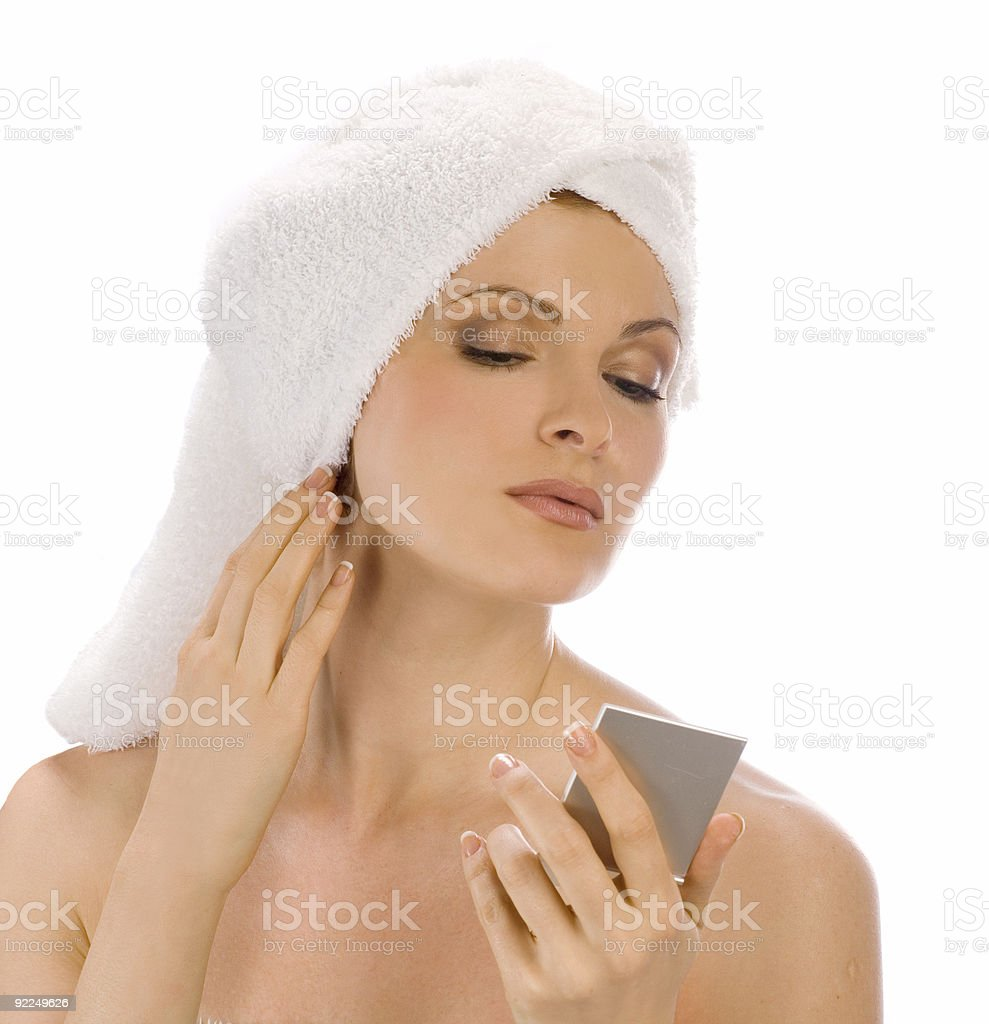 Young woman after bath with tower and mirror royalty-free stock photo