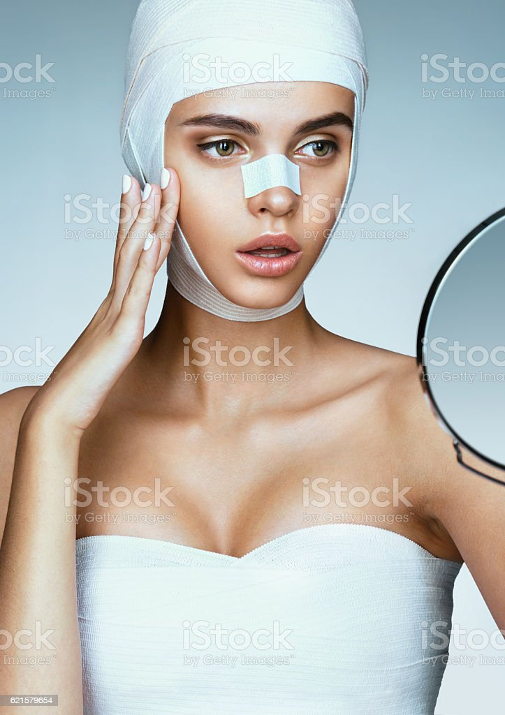 Young woman after plastic surgery stock photo