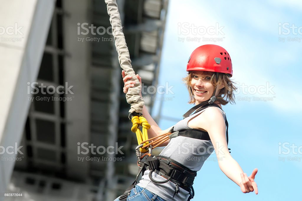 young woman after the bungee jump stock photo