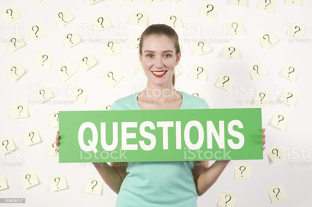 Young woman against stickers with questions royalty-free stock photo