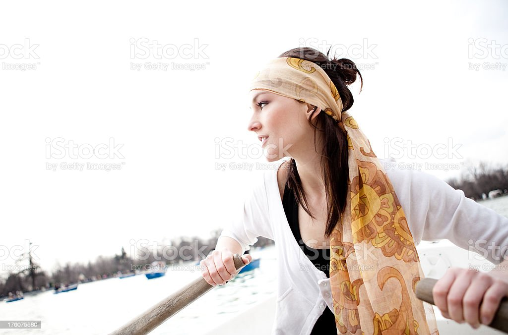 Young Woman alone in a Rowboat royalty-free stock photo